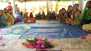 A women's group meeting in Bangladesh as part of a CAFOD project to improve food and livelihood security in the context of climate change