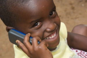 Benita, 4 years old, from Ruyenzi, Rwanda uses a phone