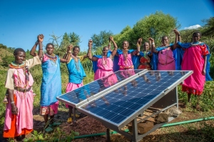 Sinteyo and the women's group with solar panels at the greenhouse, Isiolo.